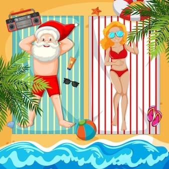 Santa claus taking sun bath on the beach with beautiful lady