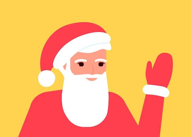 Santa claus waves his hand greets congratulates on holidays celebrates christmas and new year