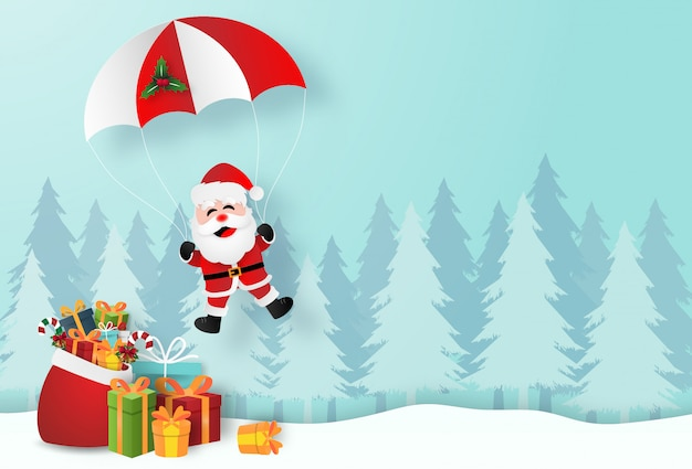 Santa claus with christmas gifts in pine forest