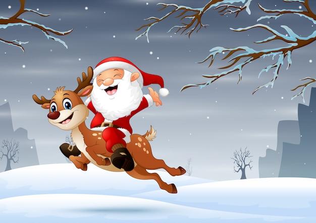 雪の中でジャンプ鹿とサンタクロース