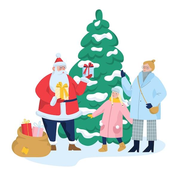 子供のためのギフトとサンタクロース。少女はサンタからプレゼントを受け取ります。大きなクリスマスツリー、家族のお祝い。図