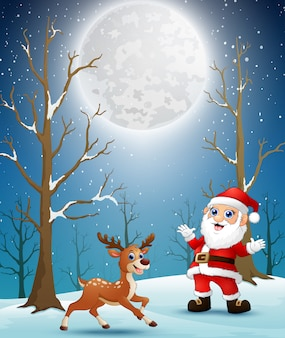 Santa claus with reindeer at christmas winter night