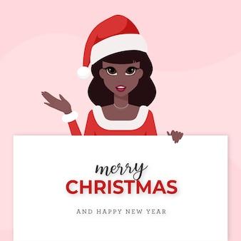 サンタクロースの女性はピンクの背景にメリークリスマスを望みます