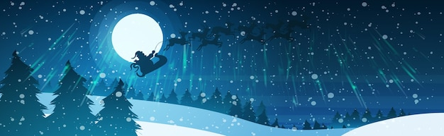 Santa flying in sleigh with reindeers in night sky over snowy pine fir tree forest merry christmas happy new year winter holidays concept