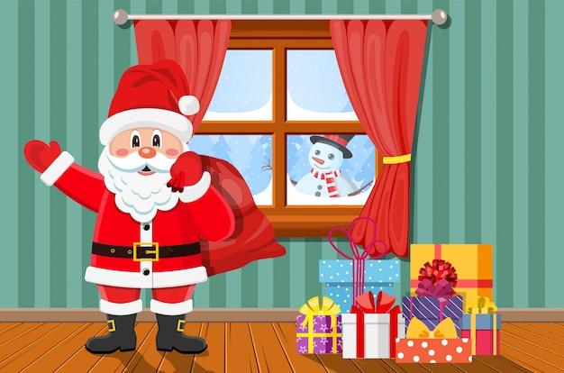 部屋のクリスマスツリーとギフトのサンタ。