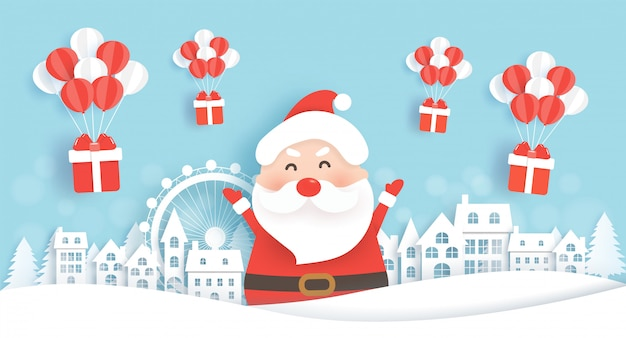 Santa in snow village with gift boxes for christmas background in paper cut and craft style