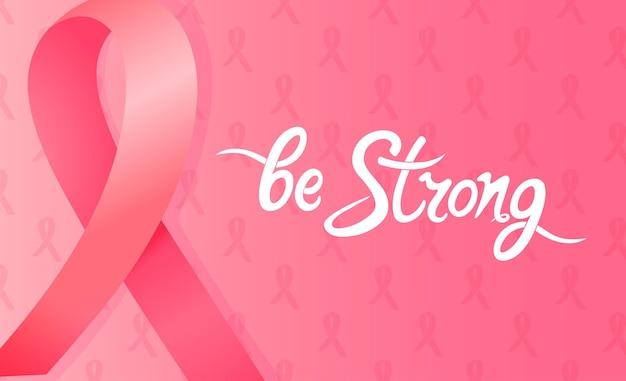 Атласная розовая лента. будьте сильными рисованной мотивационной надписью. национальная концепция месяца осведомленности рака молочной железы.
