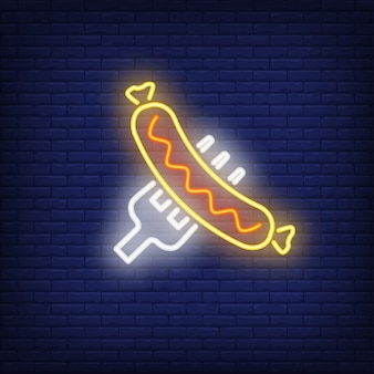 Sausage on fork on brick background. neon style illustration.