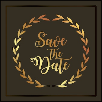 Save the date card with golden foliage and letters