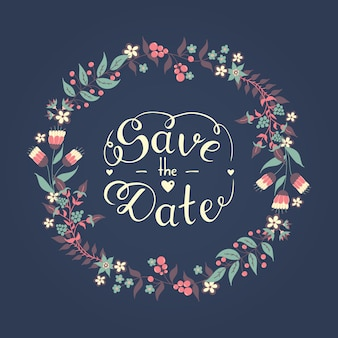 Save the date hand lettering phrase with beautiful romantic floral wreath