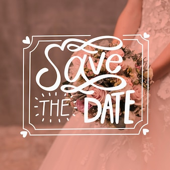 Save the date lettering with bride and bouquet