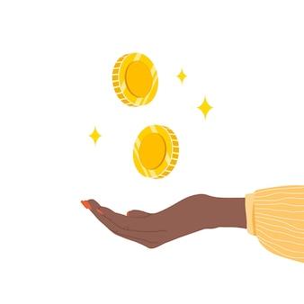 돈 개념을 저장합니다. 황금 동전을 들고 아프리카 여성 손입니다.