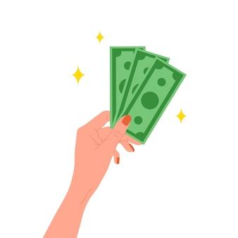 돈 개념을 저장합니다. 황금 동전을 들고 여성 손입니다.