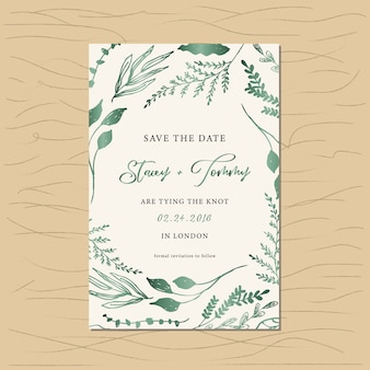 Save the date card with green metallic foliage frame
