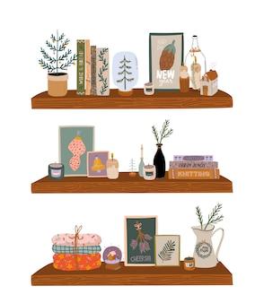 Скандинавский интерьер - книжный шкаф с зимними украшениями для дома. уютный курортный сезон. симпатичные иллюстрации и рождественская типография в стиле хюгге. . изолированный.