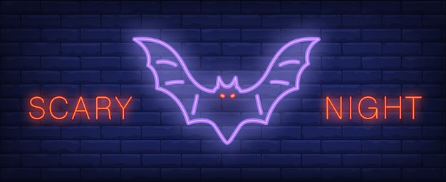 Scary night neon style lettering with glowing bat on brick wall. bright night banner.