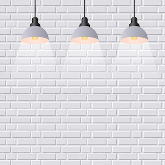 シーン照明スポットライト。灰色のレンガの壁の背景。
