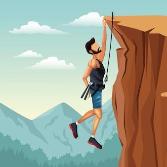 崖のロッククライミングにぶら下がっているシーンの風景の男