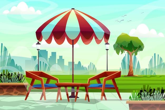 자연 공원의 푸른 잔디 근처에 커피 테이블과 우산이 있는 의자 장면