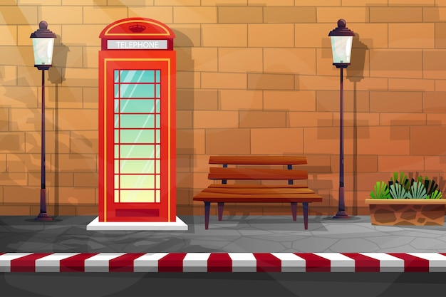 빨간 전화 부스와 벽돌 벽 근처의 나무 벤치와 높은 램프가 있는 거리의 장면
