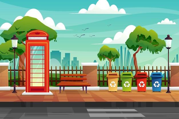 Scena di cabina telefonica e spazzatura sulla strada laterale vicino al recinto del parco naturale in città