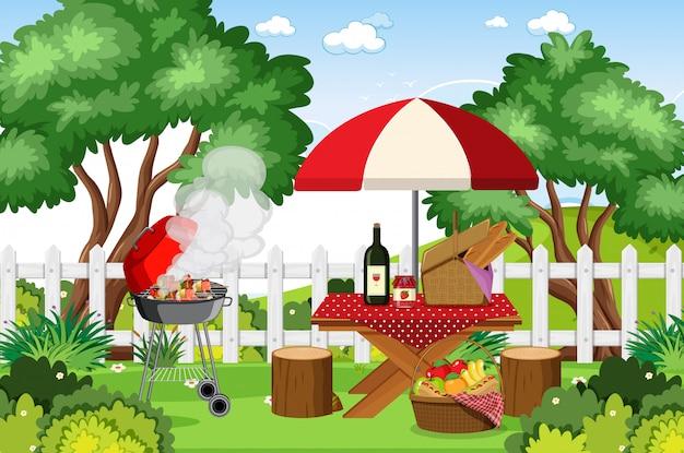 バーベキューグリルと公園のピクニックテーブルの上に食べ物のシーン