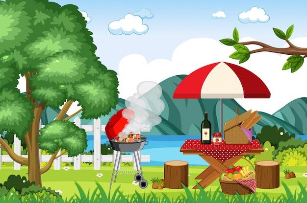 バーベキューグリルとピクニックテーブルの上に食べ物のシーン