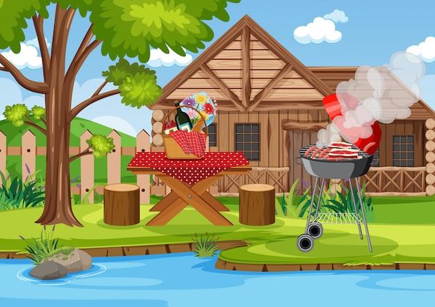 피크닉 테이블에 바베큐 그릴과 음식이있는 장면