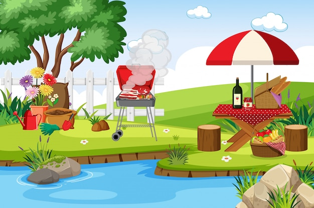 Scene with bbq grill and food on the picnic table in the park