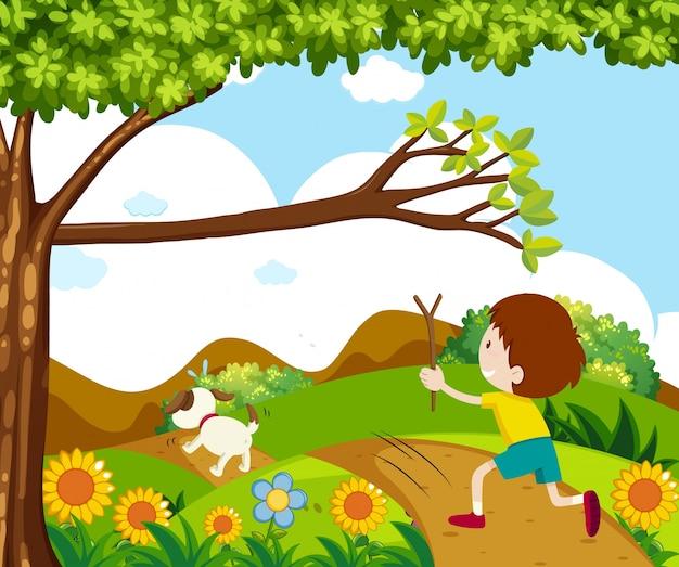 公園で犬を追う少年との情景