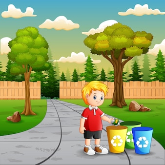 Scene with a boy putting aluminum in recycling bin