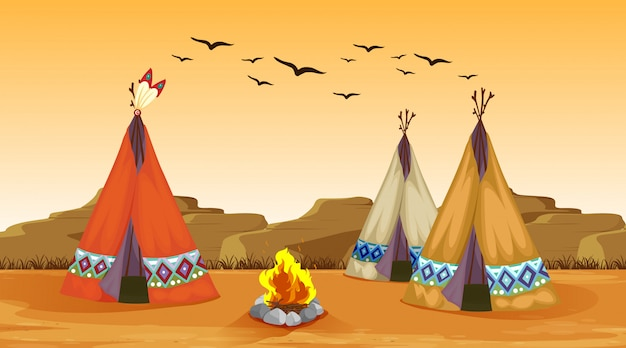 Scene with campfire and tents in the desert