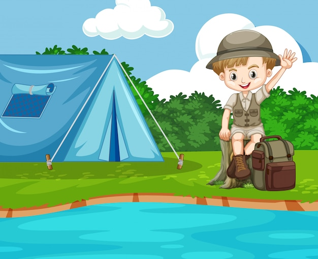 Scene with cute boy camping by the river