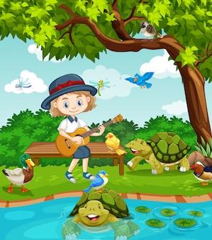 많은 동물들과 함께 공원에서 기타를 연주하는 귀여운 소녀와 함께 현장