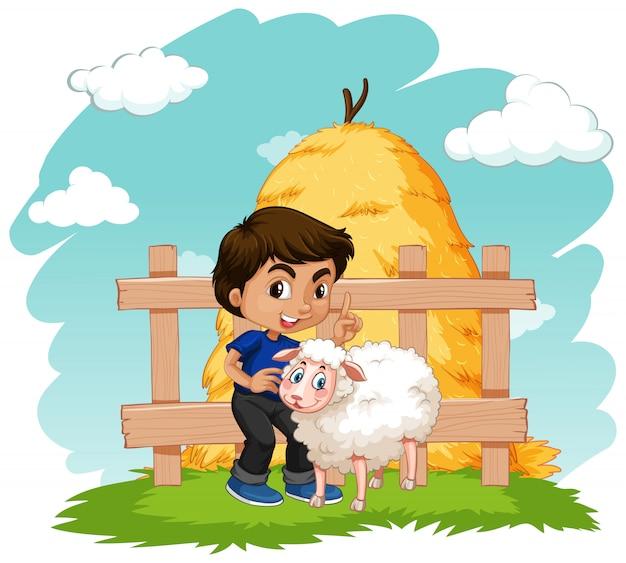 農場で農家の少年と小さな羊のシーン