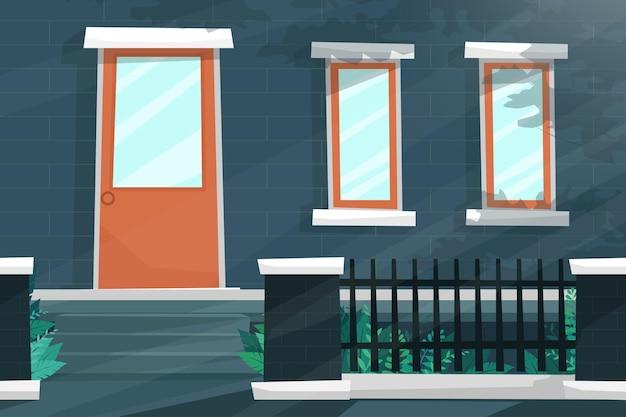 문과 창문이있는 집 앞 장면은 햇빛, 산책로 근처의 아름다운 철제 울타리로 빛납니다.