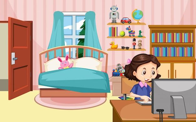 소녀는 침실에서 컴퓨터에서 작업하는 장면