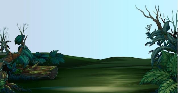 녹색 들판과 덤불이 있는 장면