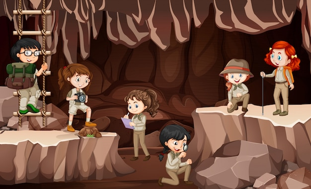 Scene with group of scouts exploring the cave