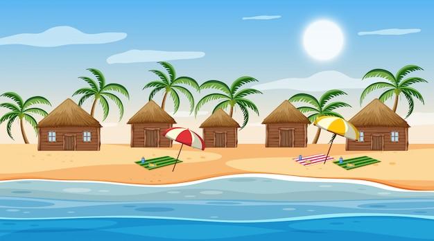 昼間のビーチで小さな小屋のあるシーン