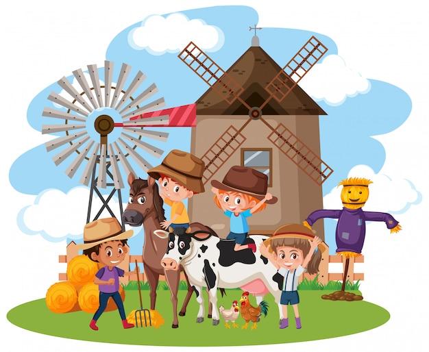 농장에 많은 아이들과 동물들이있는 장면
