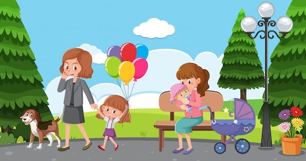 Сцена с мамами и детьми, отдыхающими в парке
