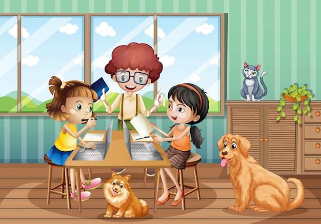 집에서 컴퓨터로 작업하는 세 아이들과 함께하는 장면
