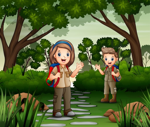 Scene with two scout hiking in the forest