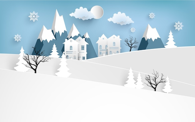家と雪の多い丘のある冬の風景