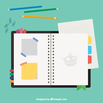 Schedule with notes and pencils