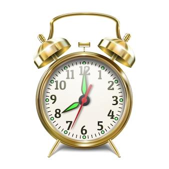 ベル付きゴールド目覚まし時計。リアルなスタイル。