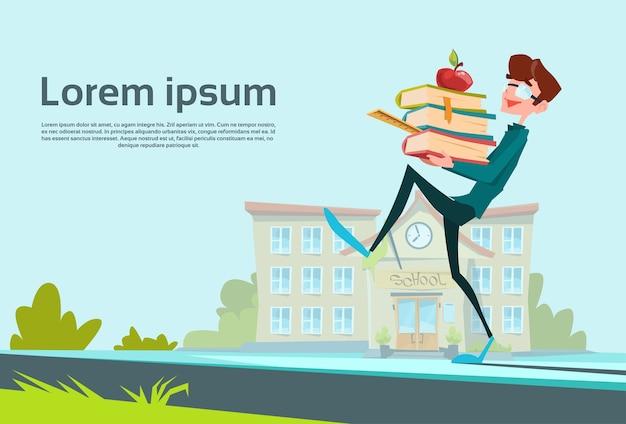 School boy carry book stack school education concept