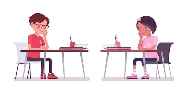 学校の男の子、勉強で忙しい机に座っている女の子