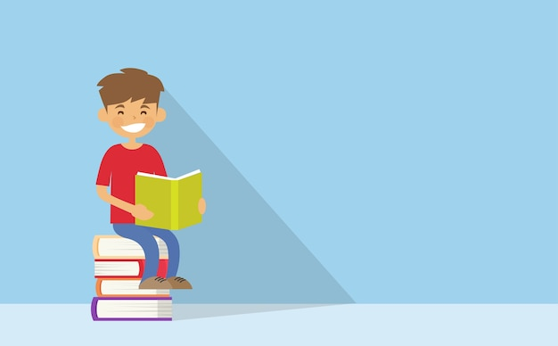 School boy reading sitting on stack of books